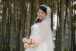 Asian woman modeling a bamboo wedding dress. Credit this image to YakoBusan CC at Flickr