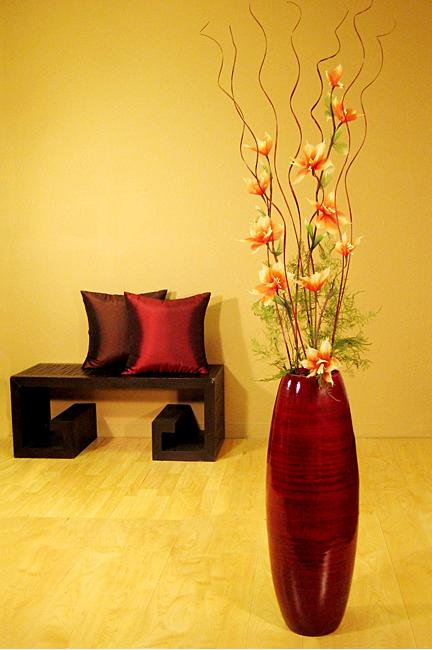 Red floor vase with lilies