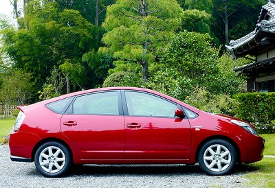 Red Toyota Prius side view by Joi on Flickr