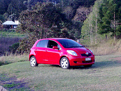Red Toyota Yaris in the backyard