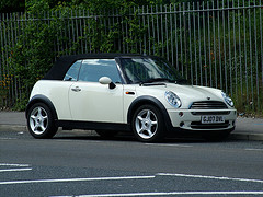 Side profile of a white Mini Cooper Convertible by kenjonbro on Flickr