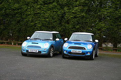 Front view of first and second generation Mini Cooper in blue by themullett on Flickr