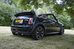 Side and rear view of black Mini Cooper S Convertible by themullett on Flickr