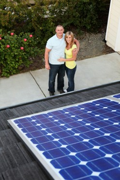 A couple admiring their new solar panels on the roof